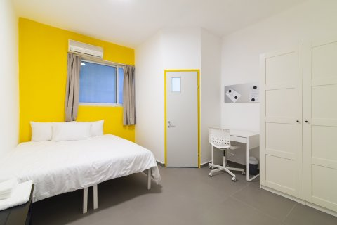 Tel Aviv-Yafo Apartments - Cozy Yellow Medium Room - Main Image